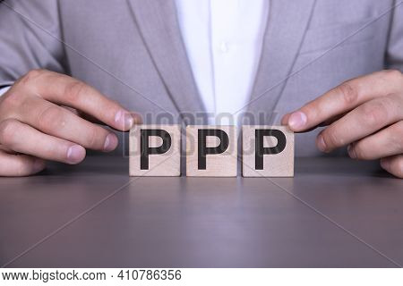 Paycheck Protection Program Ppp, The Word Is Written On Wooden Cubes, Blocks On The Background Of A