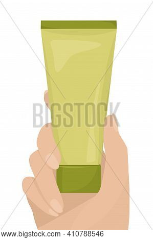 Hand Holds A Tube Of Nourishing Cream. Cream For Face And Body Skin. Skin Care And Cosmetics Concept