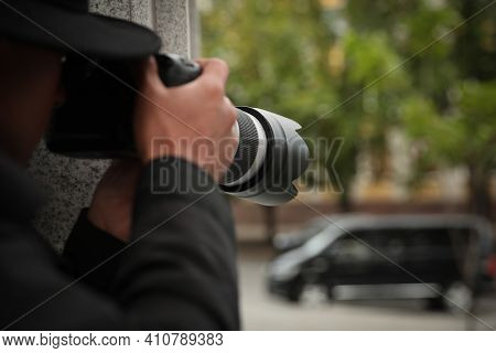 Private Detective With Modern Camera Spying On City Street, Closeup