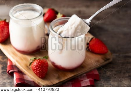 Panna Cotta Dessert With Strawberry On Wooden Table