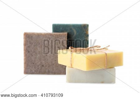 Different Handmade Soap Bars On White Background