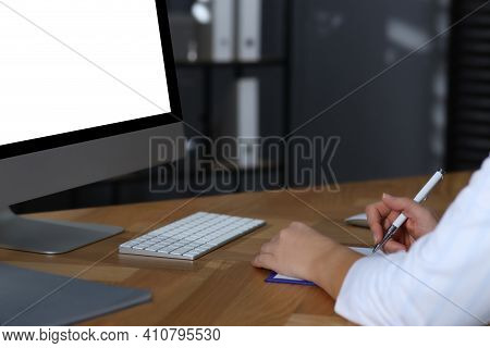 Doctor Working With Computer At Table In Office. Hotline Service
