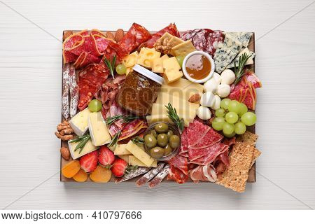 Assorted Appetizer Served On White Wooden Table, Top View