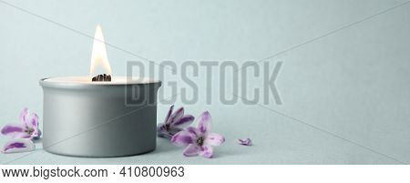 Beautiful Candle With Wooden Wick And Flowers On Light Background, Space For Text