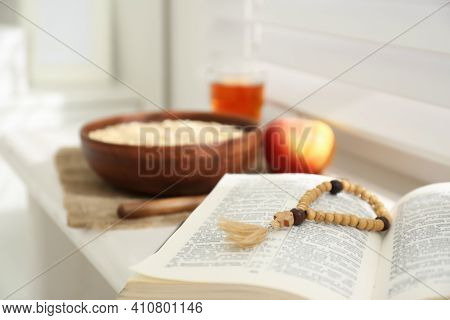 Holy Bible With Prayer Beads On Window Sill Indoors, Closeup. Great Lent Season