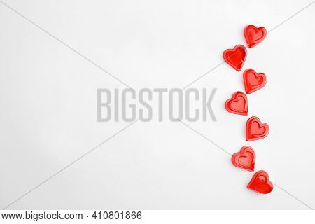 Sweet Heart Shaped Jelly Candies On White Background, Flat Lay. Space For Text