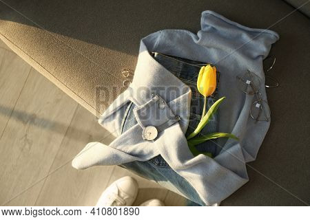 Soft Cashmere Sweater, Jeans, Accessories And Tulip On Sofa, Flat Lay