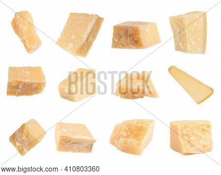 Set With Pieces Of Delicious Parmesan Cheese On White Background