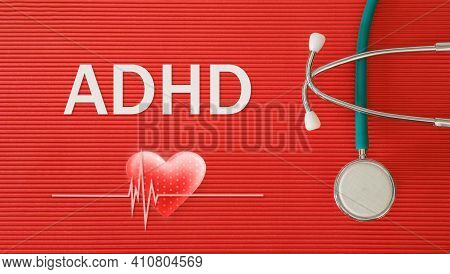Adhd - Attention Deficit Hyperactivity Disorder, Concept With Stethoscope And Heart Shape On A Red B