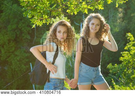 Two Girls Hiking In The Mountains. Nature And Healthy Lifestyle