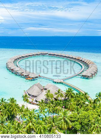 Maldives Paradise Scenery. Tropical Aerial Landscape, Seascape With Long Jetty, Water Villas With Am