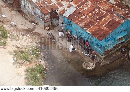 Santo Domingo, Dominican Republic - January 11, 2020: Local Men Are In Slum Of Santo Domingo On A Da