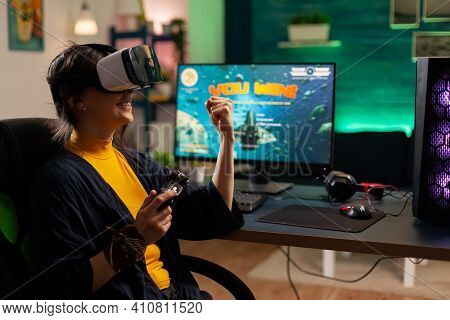 Winner Player Holding Console Playing Virtual Reality Videogame In Gaming Home Romm. Professional Pr