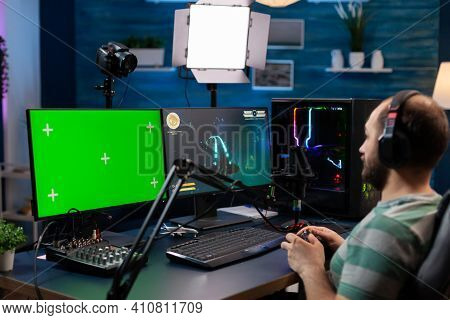 Caucasian Man Gamer Streaming Online Videogames On Professional Powerful Computer With Green Screen