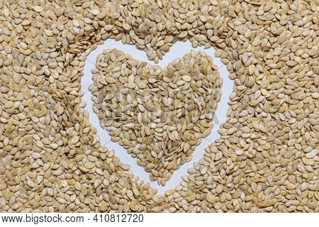 Pumpkin Seeds Are Abundant. Laid Out In The Shape Of A Heart. Healthy And Natural Food.