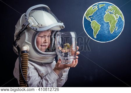 Child Dreams To Be In Space And Save The Planet. Save Earth World. World Environment Day Concept. Ki