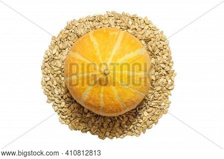 Orange Pumpkin And Its Seeds On An Isolated White Background. Healthy Vegetable Vegetarian Food. Vie