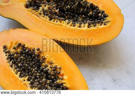 Halved Juicy Papaya, Two Halves Of Papaya With Seeds Inside, Orange Fruit Full Of Vitamins, Healthy