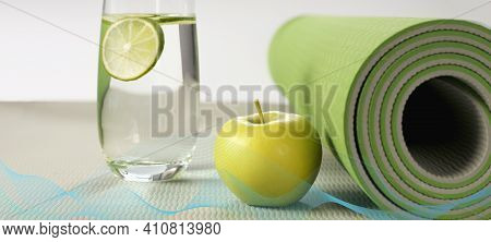 Yoga Fitness, Health Life Style. Yoga Rolled Mat, Apple, Glass Of Water With Lemon, Abstract Wave. P