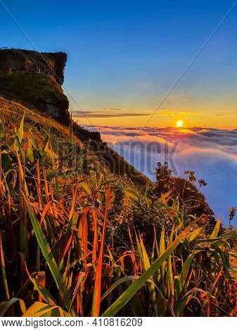 Phu Chi Fa And Mist At Sunrise In Chiang Rai Province,thailand.