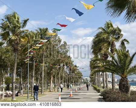 Limassol, Cyprus, March 2nd, 2021: Seafront Promenade Molos With Flag Garlands As Carnival Decoratio