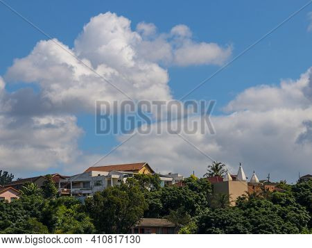 Clouds Gathering Above Residential Proprties Set In Vegetation
