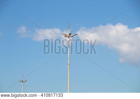 Multi Street Lights On High Pole Against Blue Sky