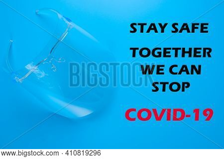 A Picture Of Face Shield With The Word Stay Safe Together We Can Stop Covid-19 On Blue Background. F