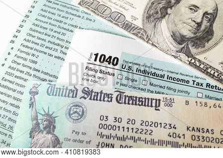 Stimulus Economic Tax Return Check And And 1040 Form With Dollars.
