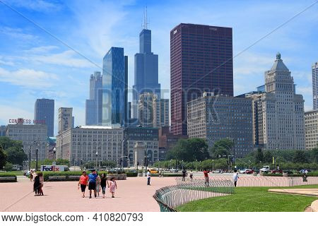 Chicago, Usa - June 27, 2013: People Visit Chicago's Grant Park. Chicago Is The 3rd Most Populous Us