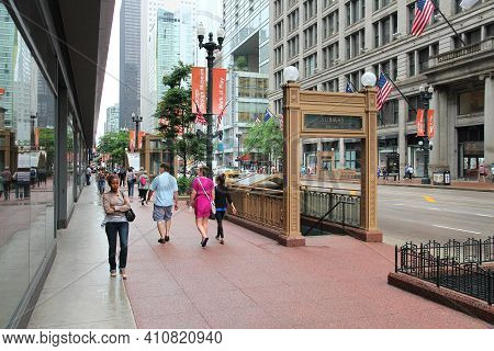 Chicago, Usa - June 26, 2013: People Walk By Subway Entrance At Michigan Avenue In Chicago. Chicago