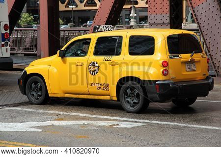 Chicago, Usa - June 26, 2013: Chevrolet Hhr Yellow Taxi Cab In Central Chicago. Chicago Is The 3rd M