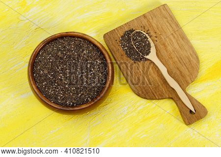 Seeds Of Chia, Salvia Hispanica Close-up. Chia Seeds In A Plate Of Natural Olive Wood. Product For B
