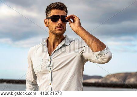 Gorgeous Stylish Man Wearing Fashionable Shirt And Sunglasses. City Style. Beautiful And Charming Ma