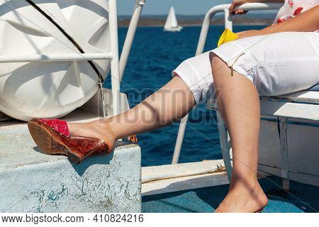 Senior female enjoying vacation on sailboat