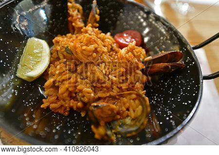 Paella Is A National Spanish Dish Made From Rice Tinted With Saffron With The Addition Of Olive Oil.
