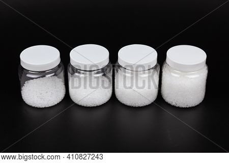 Transparent Bottle Inside With Plastic Beads. White Polymer. White Plastic Beads.