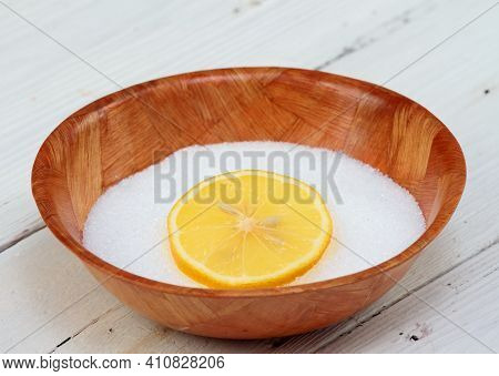 Crystalline Citric Acid In A Bowl. It Occurs Naturally In Citrus Fruit. White Wooden Table.