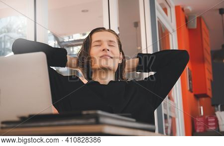 Relaxed Young Male Sit At Desk Distracted From Computer Work Take Break, Man Sit Relax At Office Wor