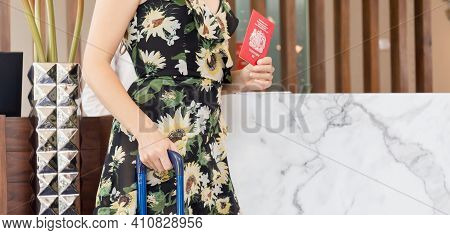 Guest With Suitcases At The Front Desk Hotel Reception, Young Travellers With Bag Travel Luggage And