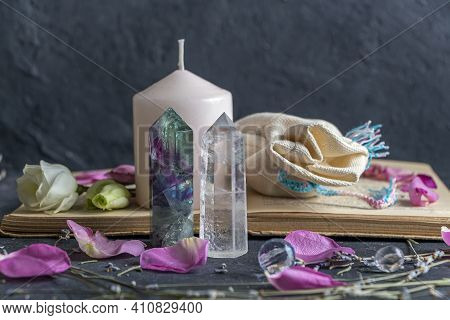 Magic Still Life With Pink Candle, Old Book, Crystals And Pagan Bag.  Esoteric And Pagan Rituals, Wi