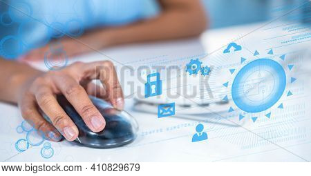 Network of connections with icons over woman using computer. global technology, business and finance concept digitally generated image.
