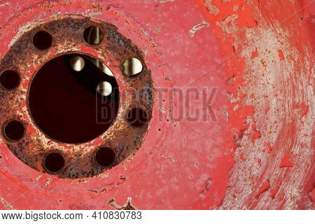 Close Up Of Old Tractor Wheel With Faded Paint