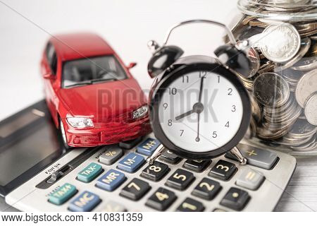 Car And Alarm Clock On Coins, Car Loan, Finance, Saving Money, Insurance And Leasing Time Concepts.