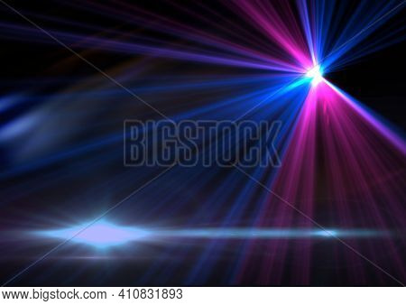 Glowing blue spots of light with blue and pink light trails on black background. light and colour concept digitally generated image.