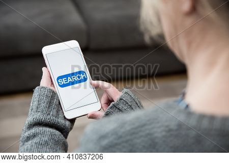 A Woman Tapping A Search Icon On Her Mobile Phone Whilst Looking For Online Content Information