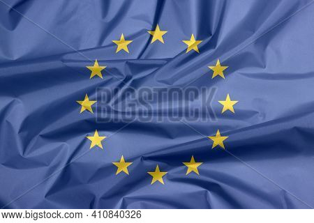 Fabric Flag Of Europe. Crease Of European Flag Background, A Circle Of Twelve Five-pointed Yellow St