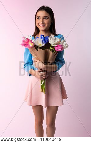 The Gorgeous Young Lady Felt Delighted To Receive A Bunch Of Womens Day Tulips On A Pink Studio Back