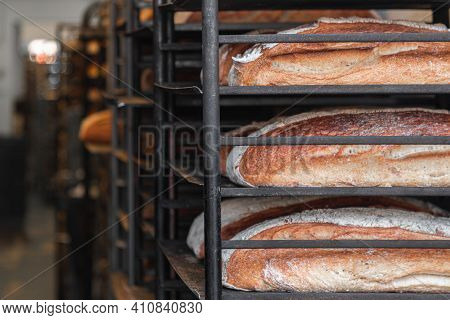 Fresh Baked Bread Lined U On Iron Metal Racking Ready For The Market