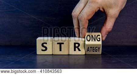 Strong Strategy Symbol. Businessman Turns A Wooden Cube With Words 'strong Strategy'. Beautiful Grey